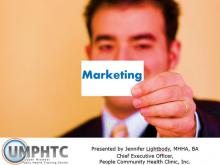 "Businessman holding up a small card in front of his face that says ""Marketing"""